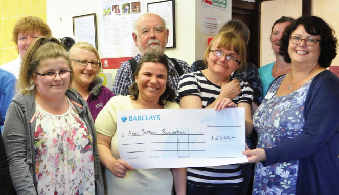 Ceri Price, Office Administrator for the Paul Sartori Foundation: Presented with a cheque for £2,000