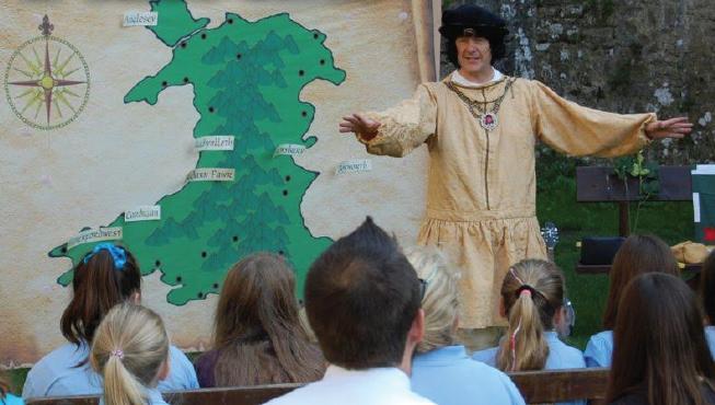 Children from Johnston C.P. School: Listening to the story of Henry Tudor at Carew Castle