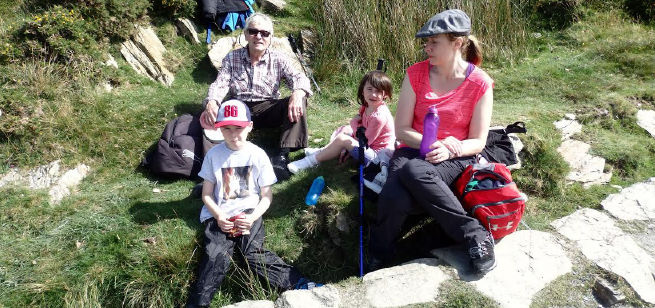 Clive Lewis: With his grandchildren, Evan and Caoimhe, and daughter in-law, Moira, on the way up Snowdon