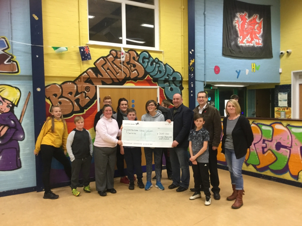 Rev. Skipworth is pictured (third from left) presenting the cheque to the young people of the centre together with youth worker Jade Thomas, Mark and James.